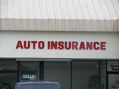 office with red auto insurance sign