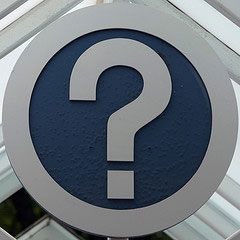 question mark on white circle sign